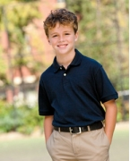 Logo Harriton Youth 5.6 oz. Easy Blend Polo